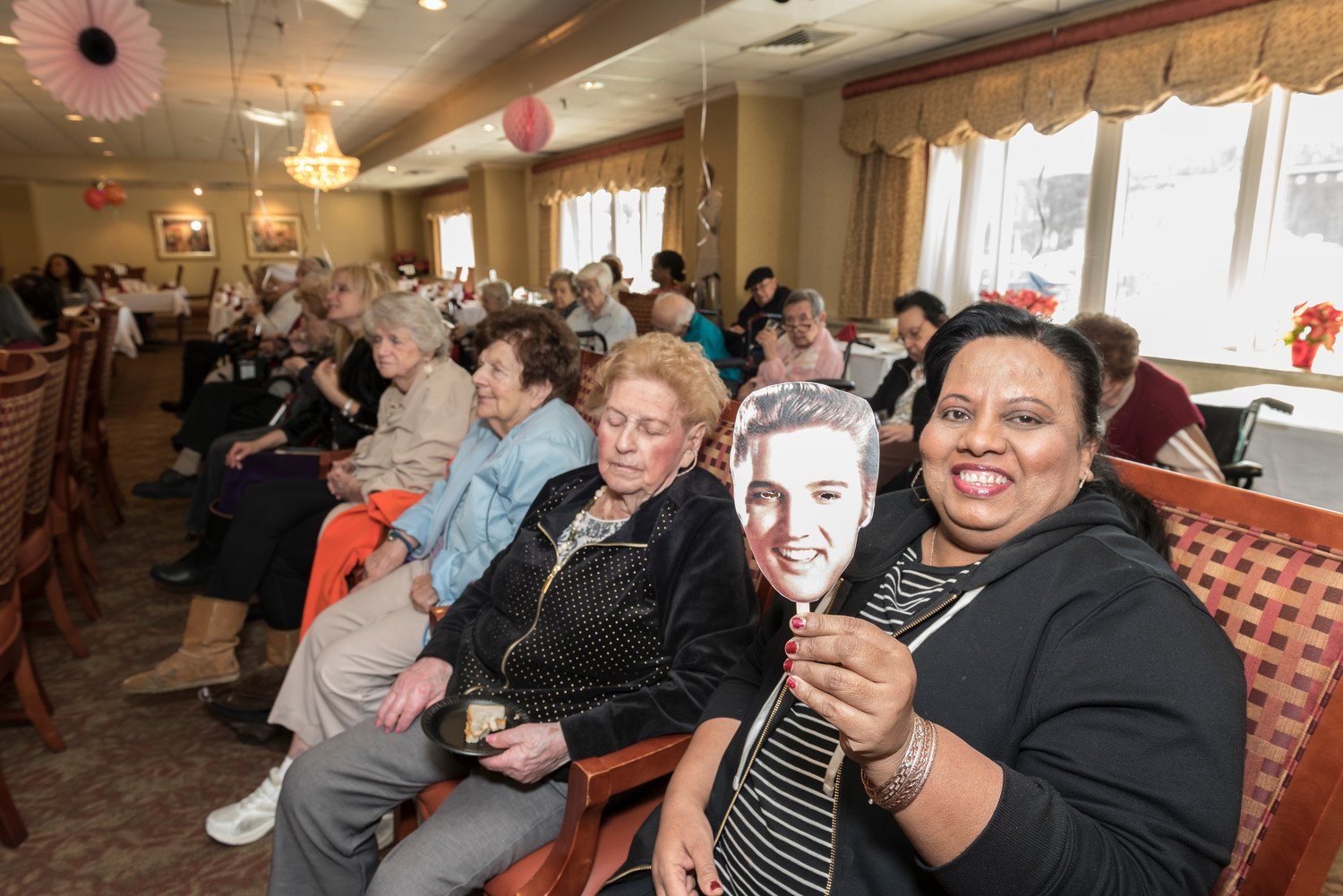 Kamala Singh shows off her Elvis mask, which were distributed to concertgoers.