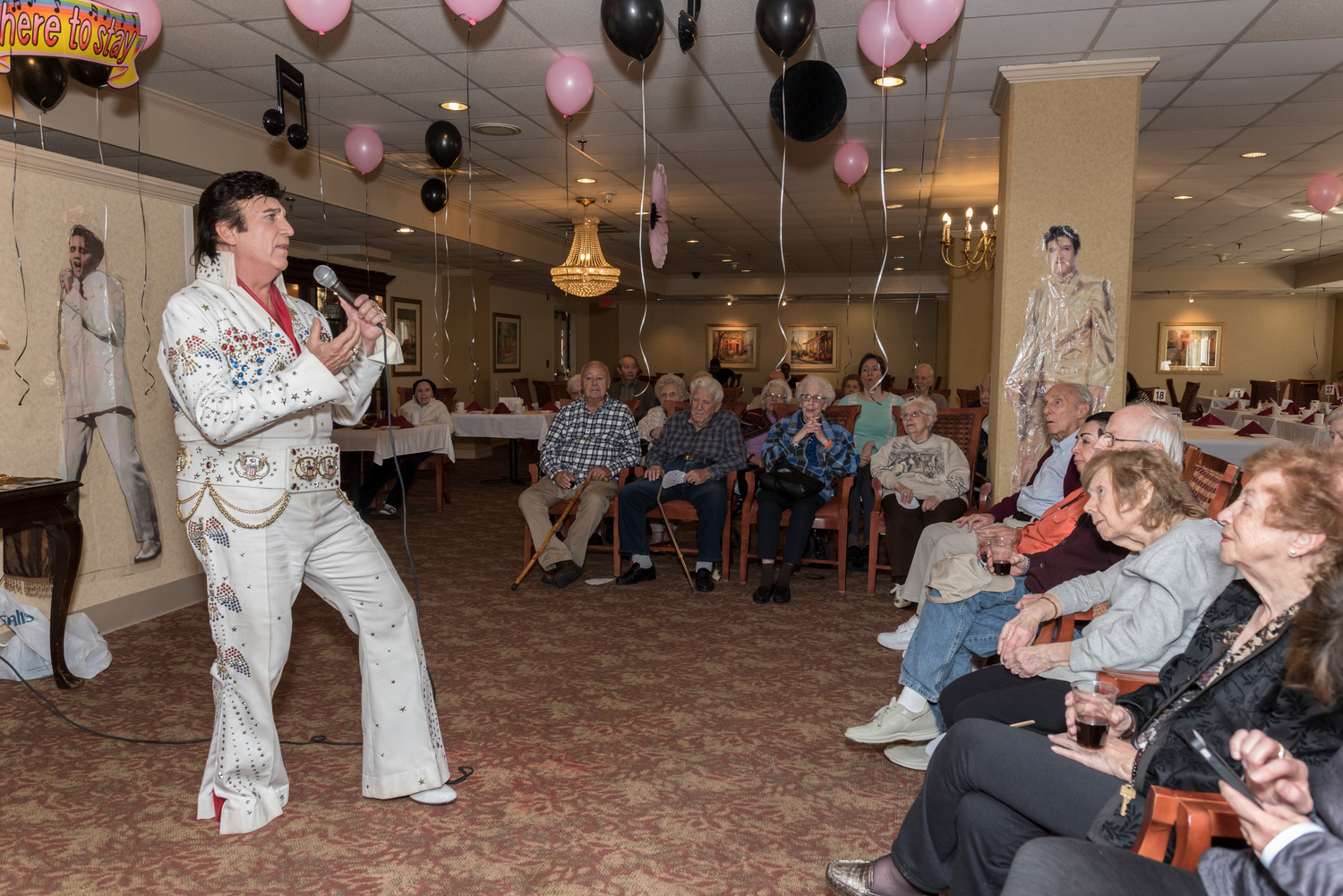 Elvis' birthday décor included pink and black balloons, music notes, and cutouts of the king hanging on the walls.