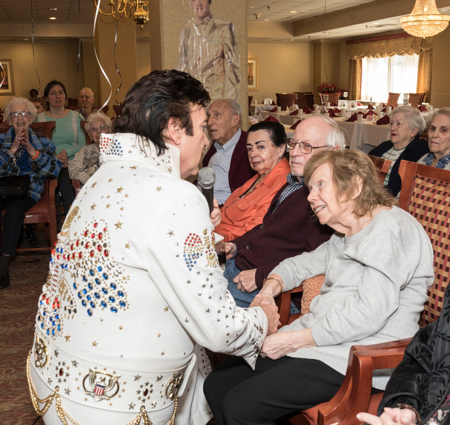 Joan Brannan, right, enjoys a special moment with Elvis as he sings to her.