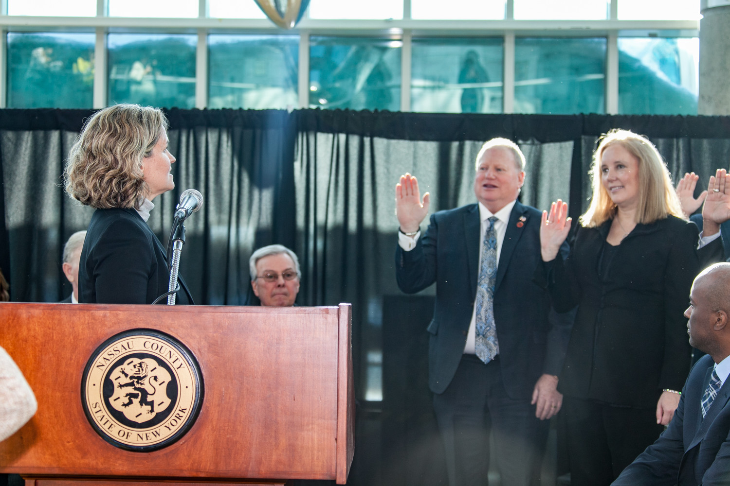 County Executive Laura Curran, left, swore in Delia DeRiggi-Whitton for her fourth term as county legislator.