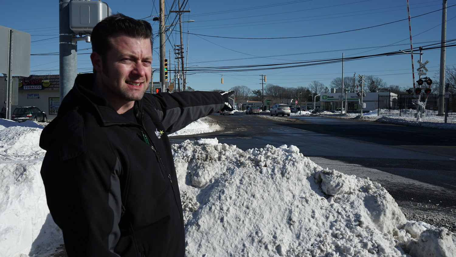 "Island Park business owner Mark Taglianetti indicated the railroad crossing where he helped tow a car that had become stuck during the Jan. 4 blizzard. ""It felt like an eternity,"" he said. ""But it was probably only 10 minutes from the time I stopped to when we were moving again."""