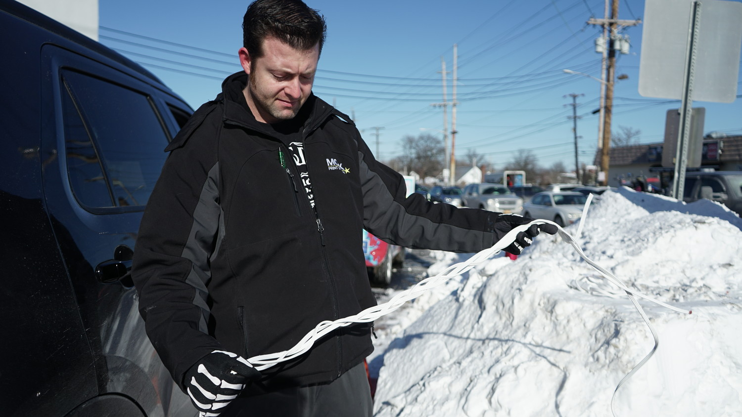 Taglianetti bought three extension cords from a nearby convenience store and braided them together, creating a makeshift tow cable.