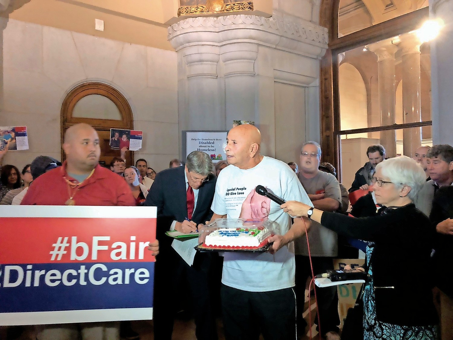 Former State Assemblyman Harvey Weisenberg led a rally in the state capitol on Dec. 6 to push legislators to speed up wage raises for those who care for people with disabilities.