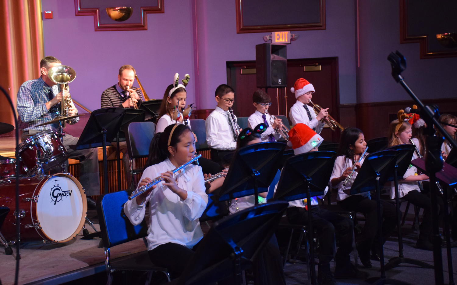 "Holiday ensembles composed of students from the Bowling Green and Barnum Woods elementary schools performed ""Jingle Bells"" for the community."