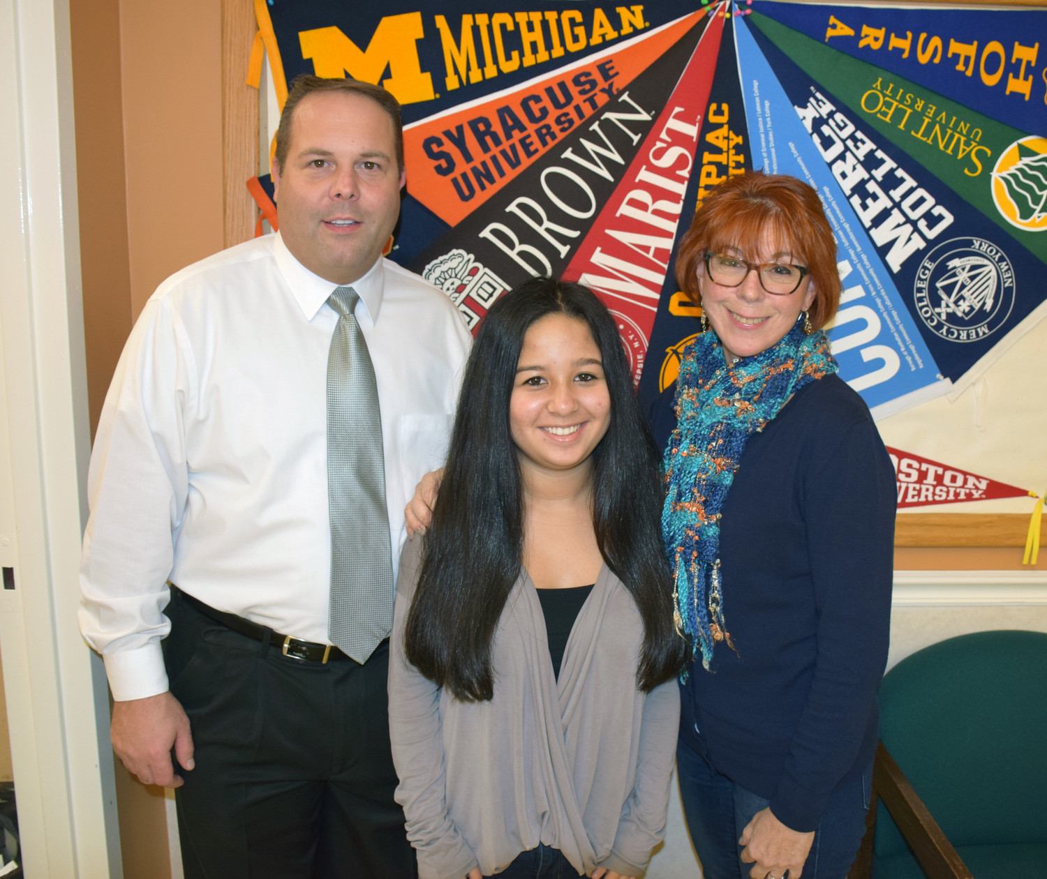 Leilani Blakeman, a sophomore at East Meadow High School, center, was named a Hugh O'Brian Youth Leadership ambassador for the 2017-2018 academic year. She is pictured here with William Brennan, the dean of students, left, and Mona Allen, the chairperson of the HOBY Committee and a guidance counselor at the high school.