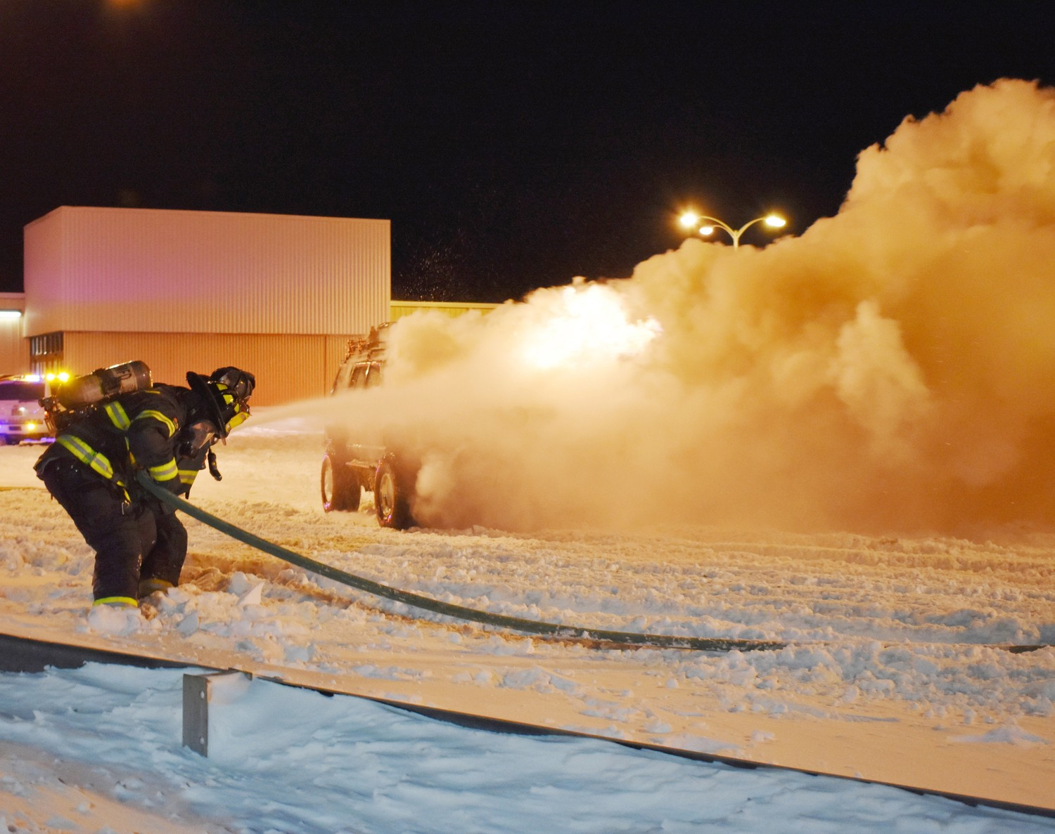"Fighting extreme weather conditions, the ""First Due"" crew of Engine Company 2 stretched an attack hose line, and began extinguishing a truck fire in the Home Depot parking lot on Jan. 5."