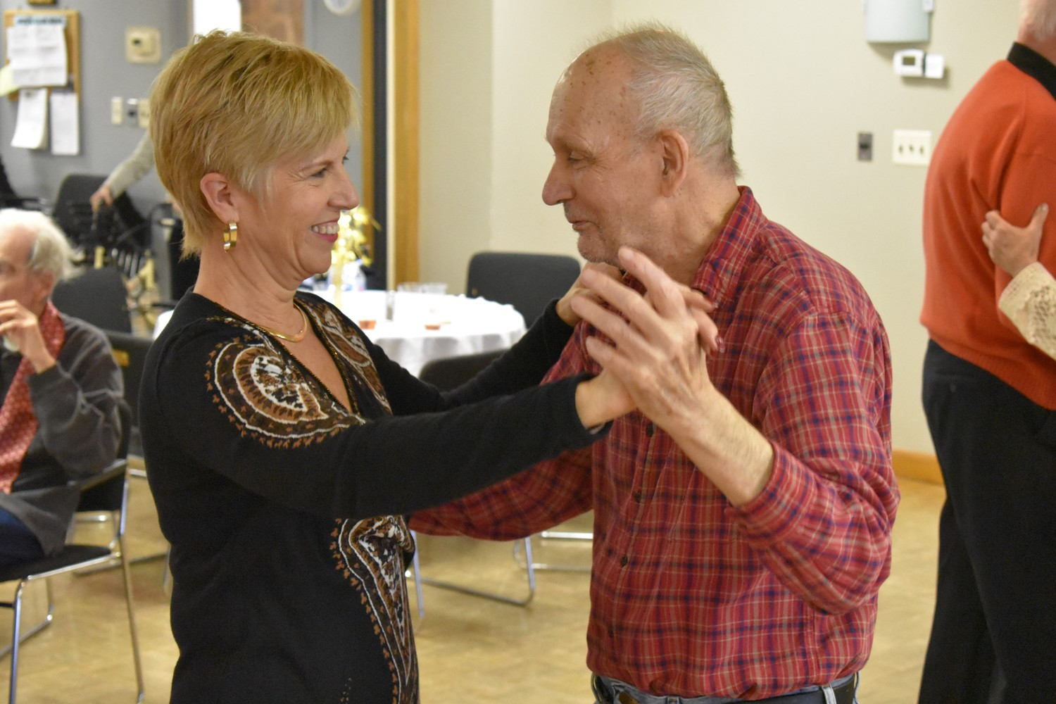 Chris O'Leary, left, director of the Sandel Senior Center, danced with Jesse Langdon.