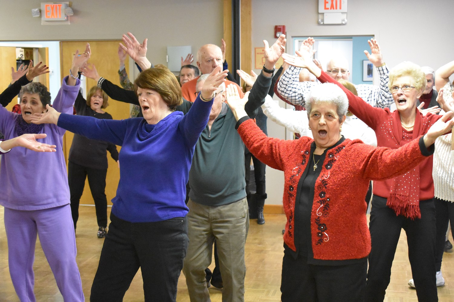 "Carol Kramer, in blue, and Carmen Flamini, right, danced to ""YMCA."""