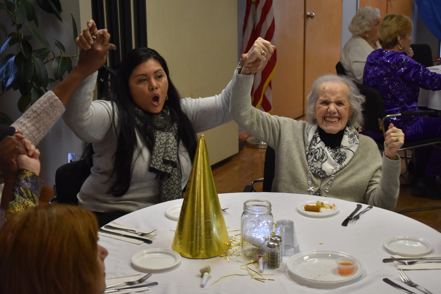 "Linda Licona, left, and Lee Naro sang ""Sweet Caroline."""