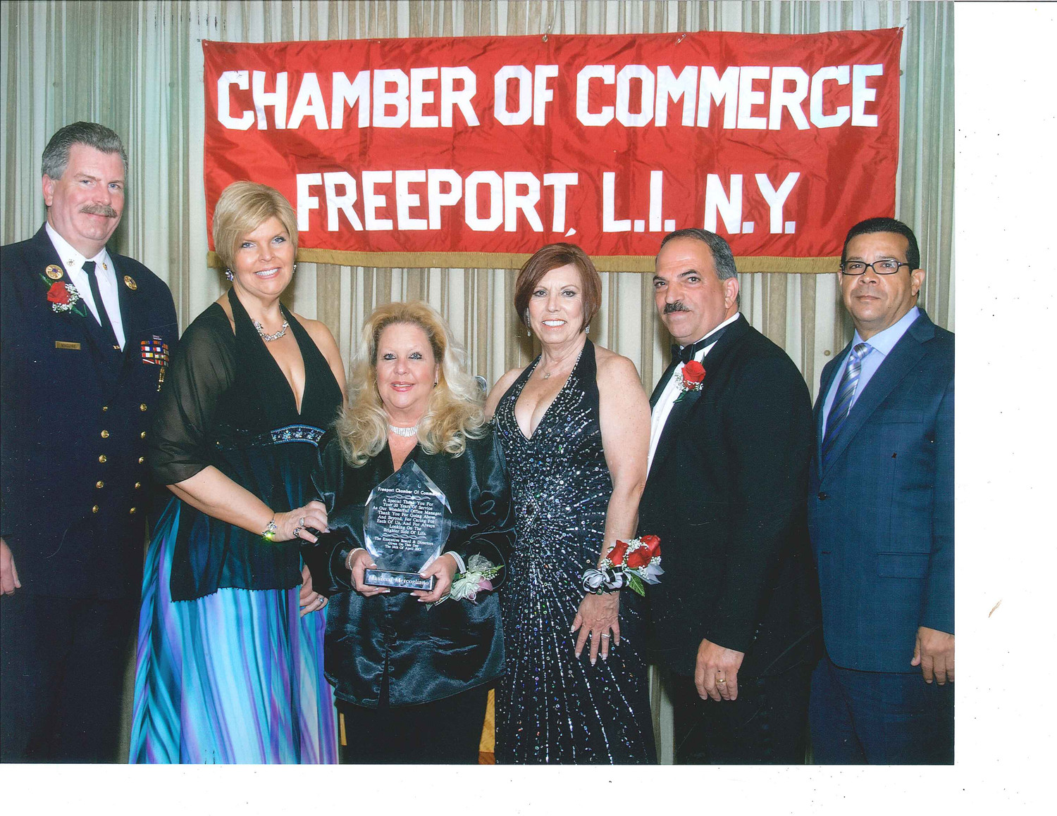 Maureen Mercogliano was given an award of recognition for 10 years of service to the Freeport Chamber of Commerce in 2011. From left were Ray Maguire, executive director of the Freeport Fire Department; Ilona Jagnow, owner of Otto's Seagrill; Mercogliano, Jerri Quibell; former chamber President John Nuzzi; and Francisco Jorge.