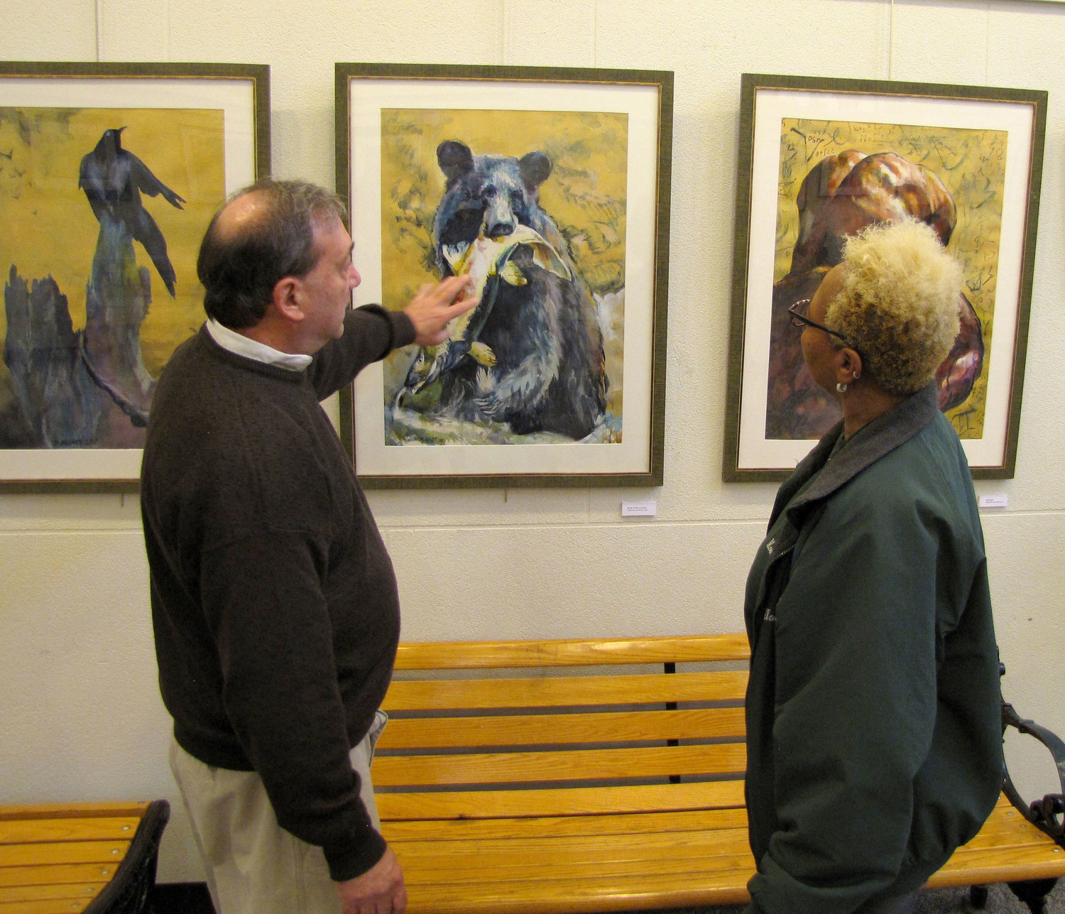 Marc Josloff, left, talked about his paintings with Freeporter, Peggy Bickett at the Freeport Memorial Library on Jan. 8.