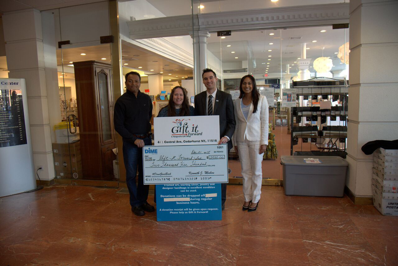 Dime Community Bank donated $6,835 to Gift It Forward Inc. Kulanu Academy and the Five Towns Early Learning Center as part of the DimeGivesBack initiative. From left were Patrick Dure, Gift It Forward owner Miriam Dure, Cedarhurst branch manager Christopher Reide and assistant manager Sadana Singh.