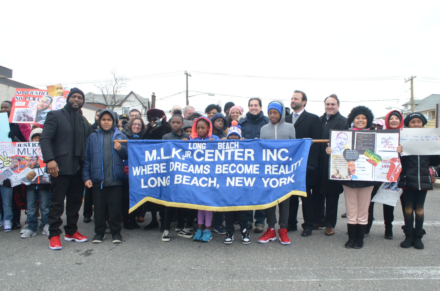 Hundreds of people marched along W. Park Avenue Monday morning to commemorate the life of Dr. Martin Luther King Jr.