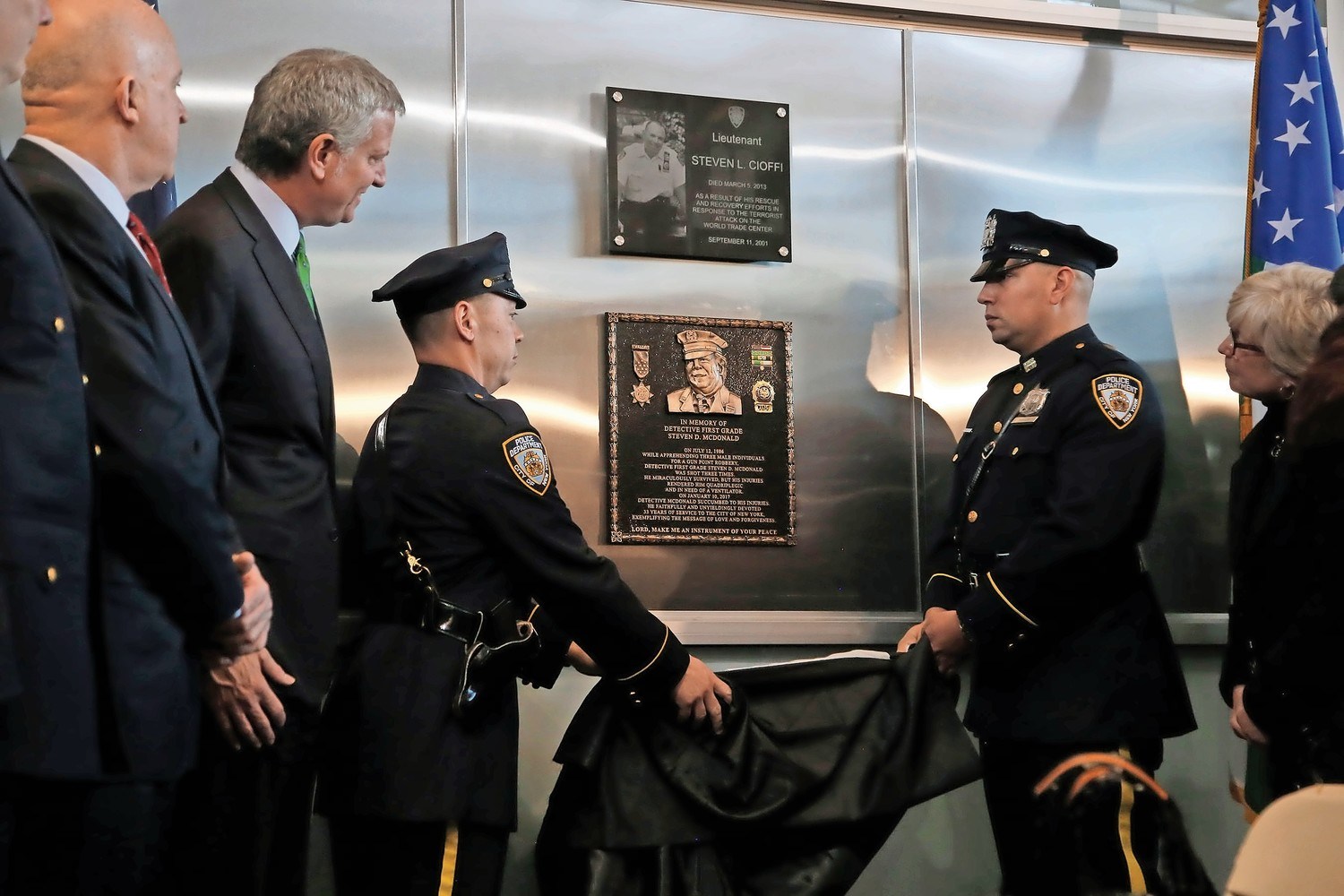 Officers unveiled McDonald's plaque at the precinct.