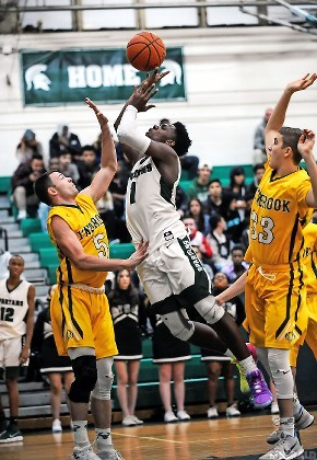 Senior Taliq Abdul-Rahim, center, scored a career-high 35 points but it wasn't enough for Valley Stream North to overcome Lynbrook on Jan. 3.