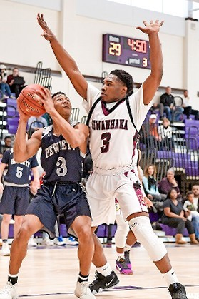 Hewlett's Alyjah Hill, left, who had 12 points, worked against Sewanhaka's Jazier Whitely during last Saturday's 66-57 loss to the Indians.