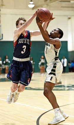 South Side's Will Speechley, left, vied for a loose ball with Elmont's Conrad Ihaza during a rematch of the past two Nassau Class A championship games on Jan. 8.