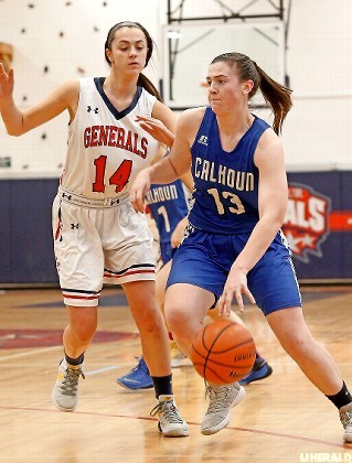 Calhoun's Katie Healy, right, keyed the Lady Colts' come-from-behind 51-41 victory at MacArthur on Monday afternoon scoring 12 of her 18 points in the second half.
