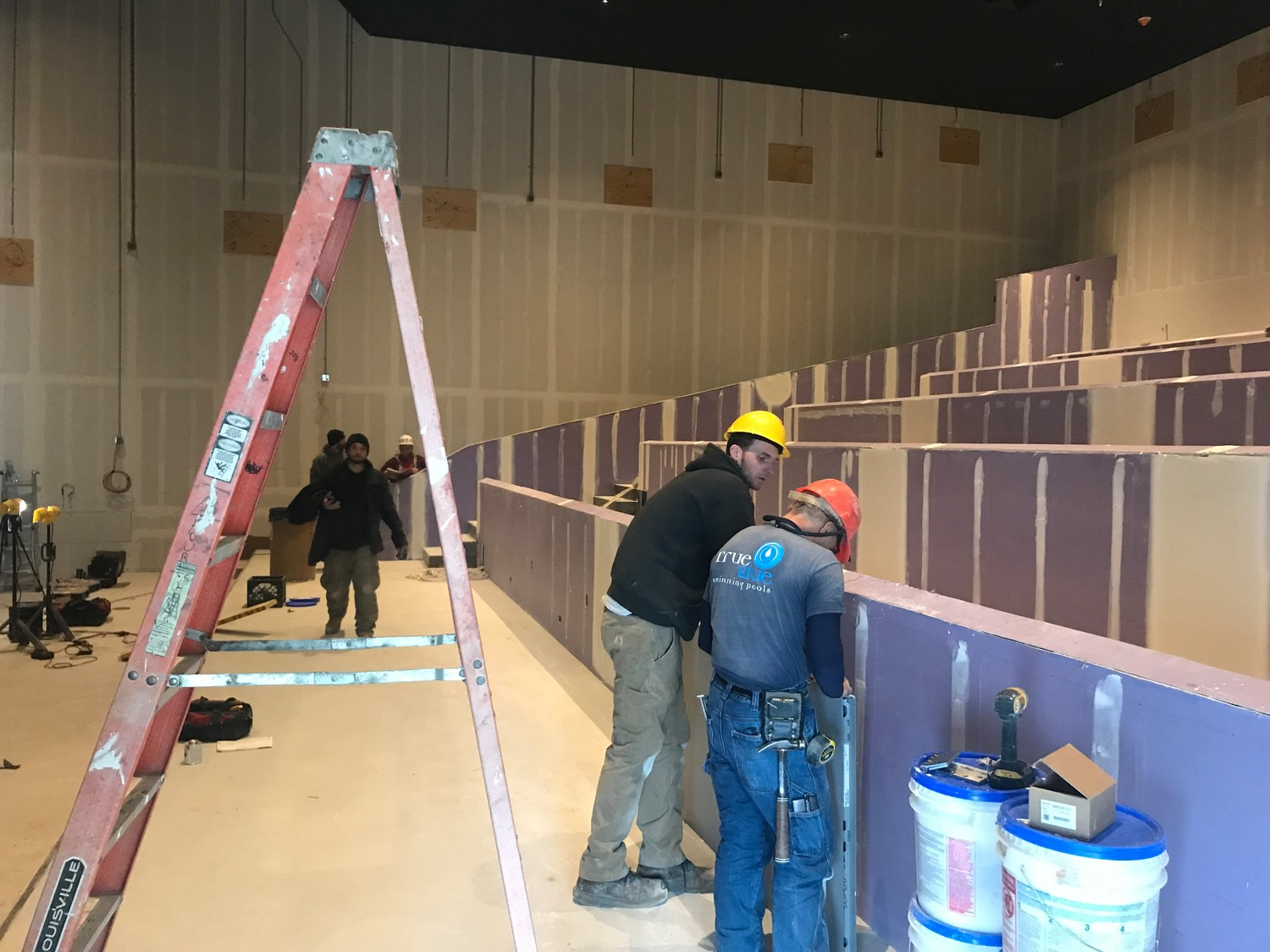 Construction crews have worked on the Regal theater for about nine hours a day from Monday through Saturday each week.