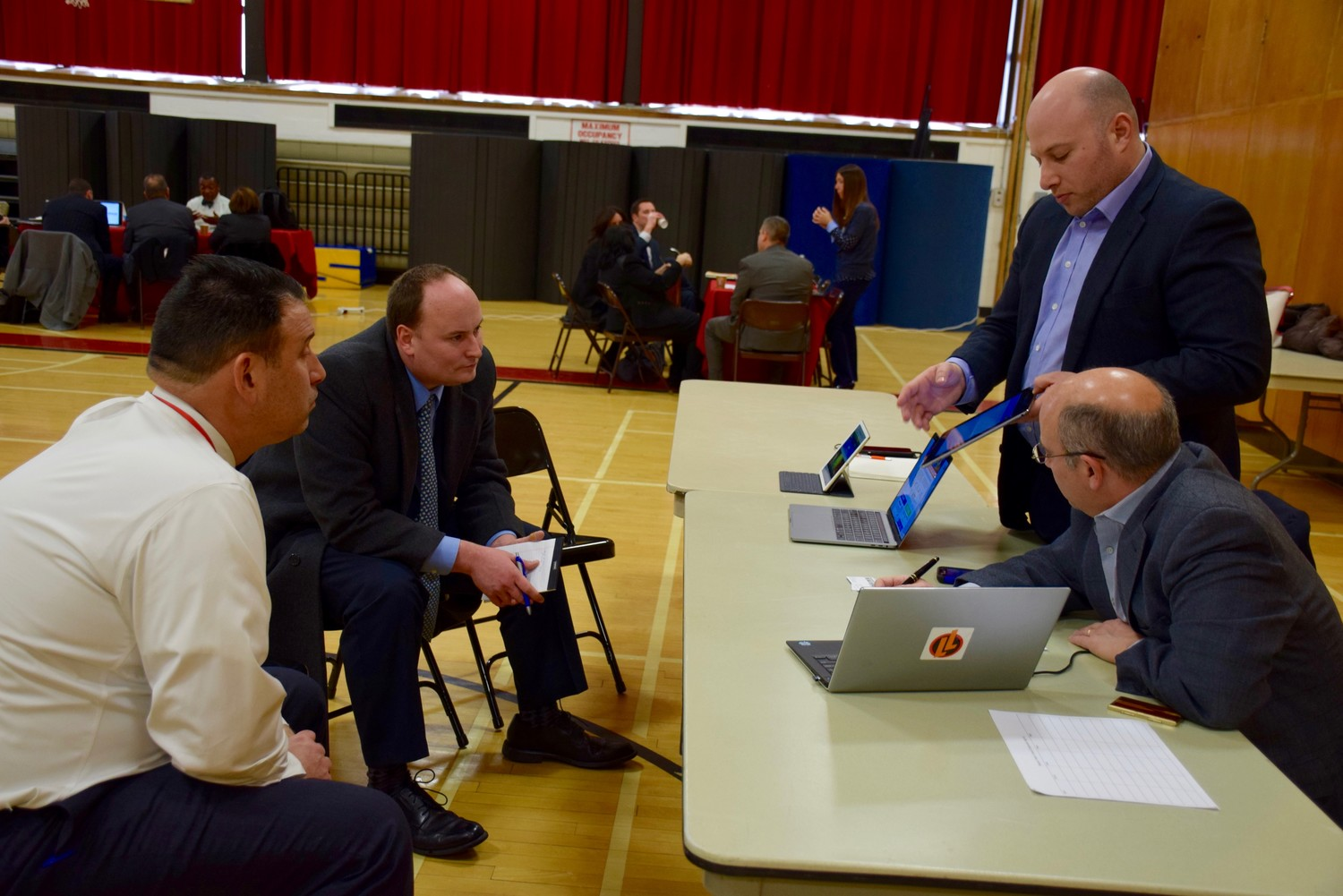 Josh Goldenberg of Legends of Learning, far right, spoke to Gerard Beleckas, Lynbrook's assistant superintendent for curriculum, instruction and assessment, second from left, and Plainedge Superintendent Dr. Edward Salina at a technology symposium at Levittown Memorial Education Center.