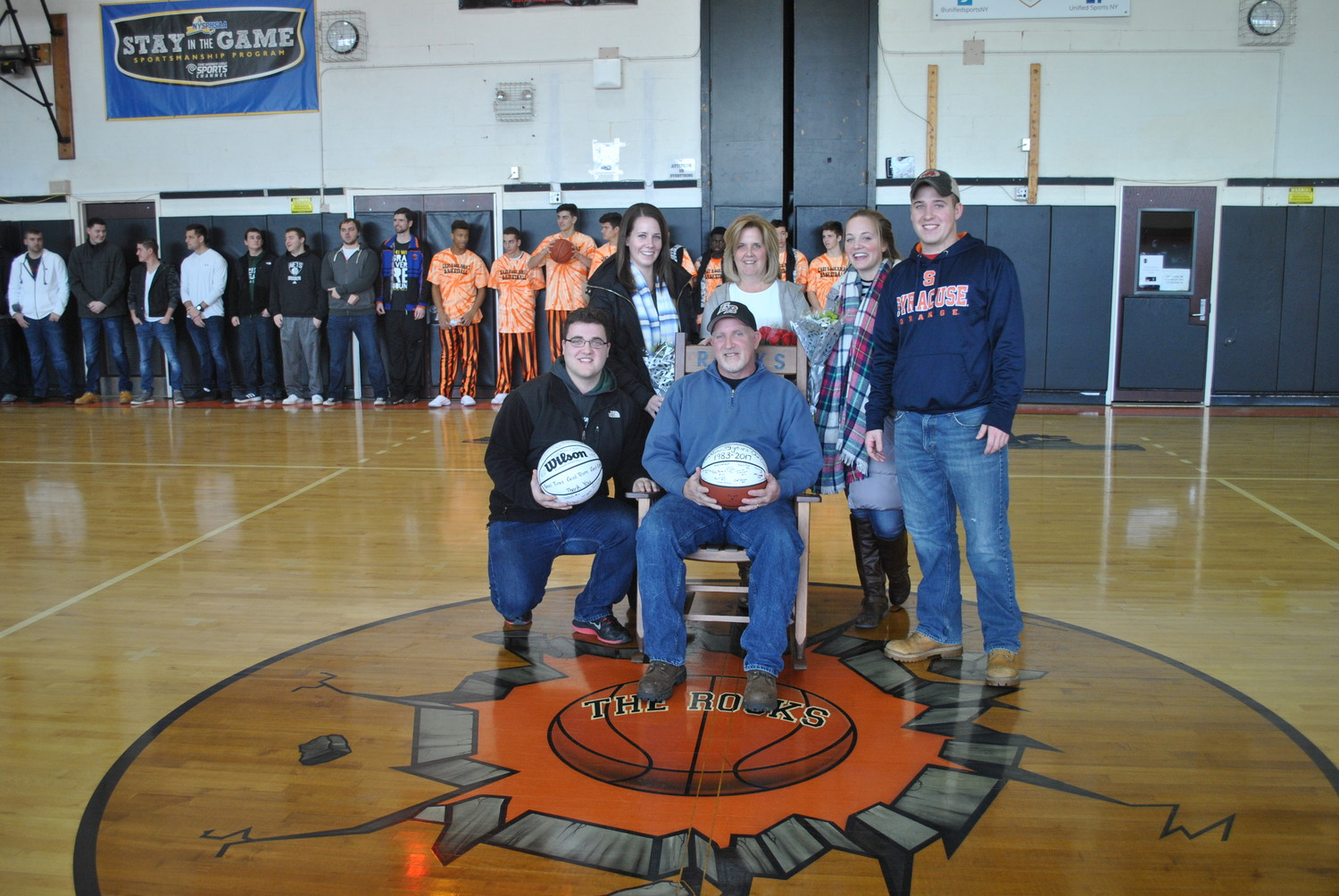 Joe Lores, center, was honored for 35 years as head coach of the East Rockaway boys' basketball team. Above, he was surrounded by his son Joe, left, daughter Katelyn, wife Eileen, daughter Jennifer and son Michael.
