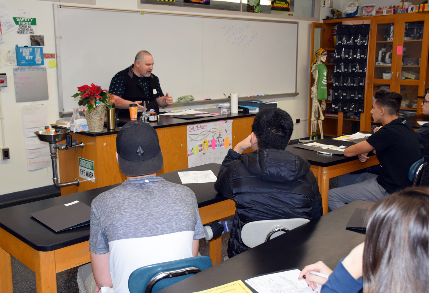 John Massella, retired police officer with the New York Police Department, educated students about law enforcement during W.T. Clarke High School's first Career Day.