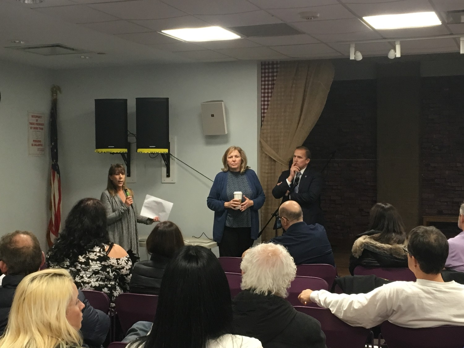 State Assemblywoman Melissa Miller, far left, County Legislator Denise Ford and county Office of Consumer Affairs representative Kenneth Heino offered guidance to residents at a forum on Jan. 11.