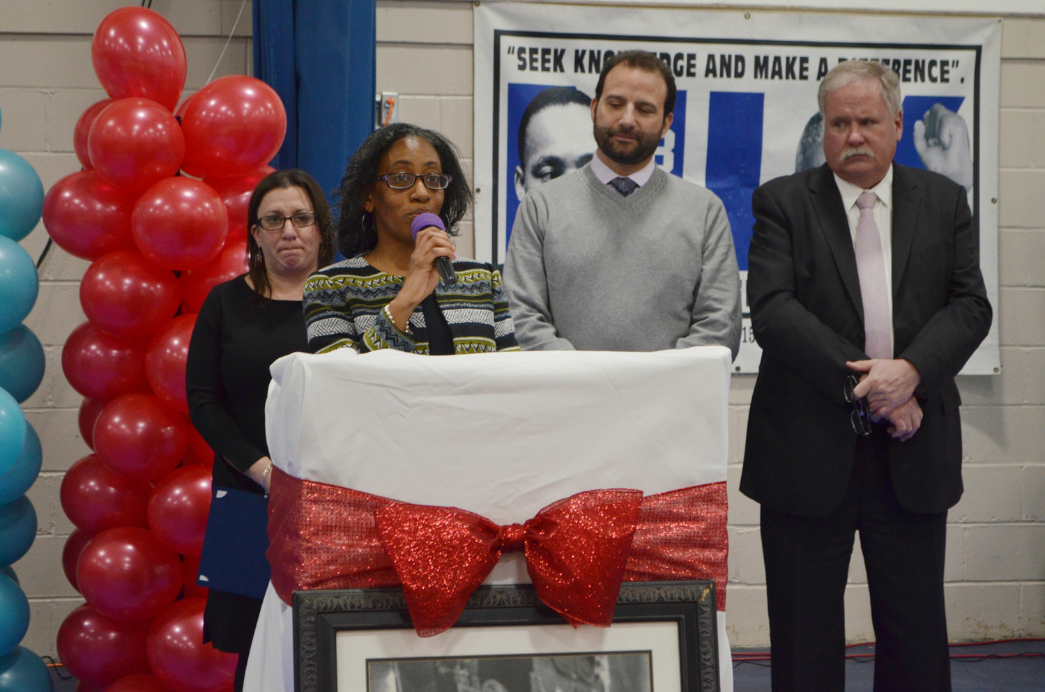 Councilwoman Anissa Moore, joined by Council Vice President Chumi Diamond, far left, Council President Anthony Eramo and Acting City Manager and Police Commissioner Michael Tangney, spoke to a crowd of hundreds at the MLK Center.
