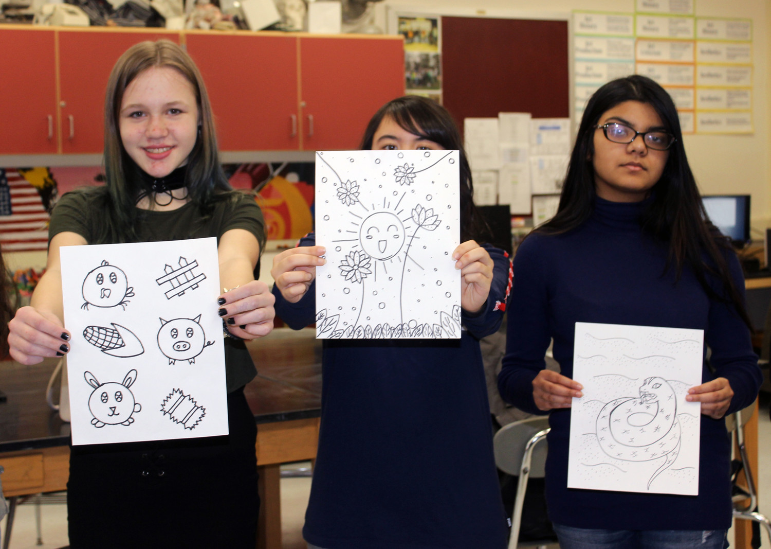 Sarah Carlson and Samantha Jaeckel, both sophomores at W.T. Clarke High School, and Sumaiya Ahmed, a senior, illustrated pages to be included in a coloring book to be distributed throughout the Nassau University Medical Center's pediatric units.