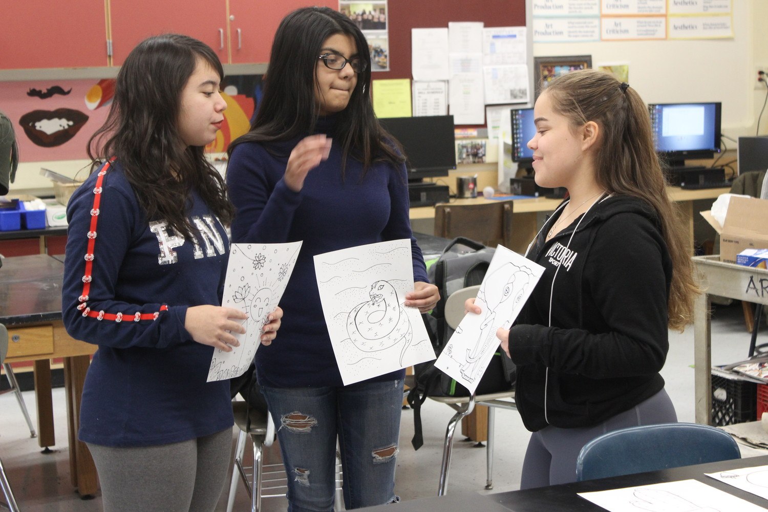 Sophomore Samantha Jaeckel, senior Sumaiya Ahmed, and junior Vanesa Soto shared with each other the illustrations they created.