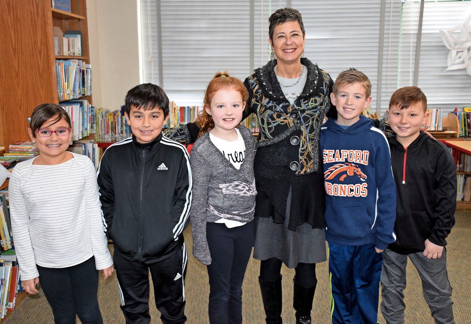 Reason2Smile Executive Director Donna Rosenblum joined Seaford Manor Elementary School third-graders, from left, Claire Reeves, Max Arnold, Emma Clancy, Ryan DeHaan and Vincenzo Casha during International Week on Jan 8-12.
