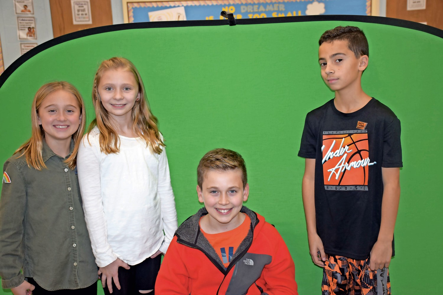 Forest Lake Elementary School fifth-graders, from left, Lyla Ingrilli, Madelyn Young, Francesco Pellicoro and John Nocero used a green screen to film their weather reports during a STEAM class.