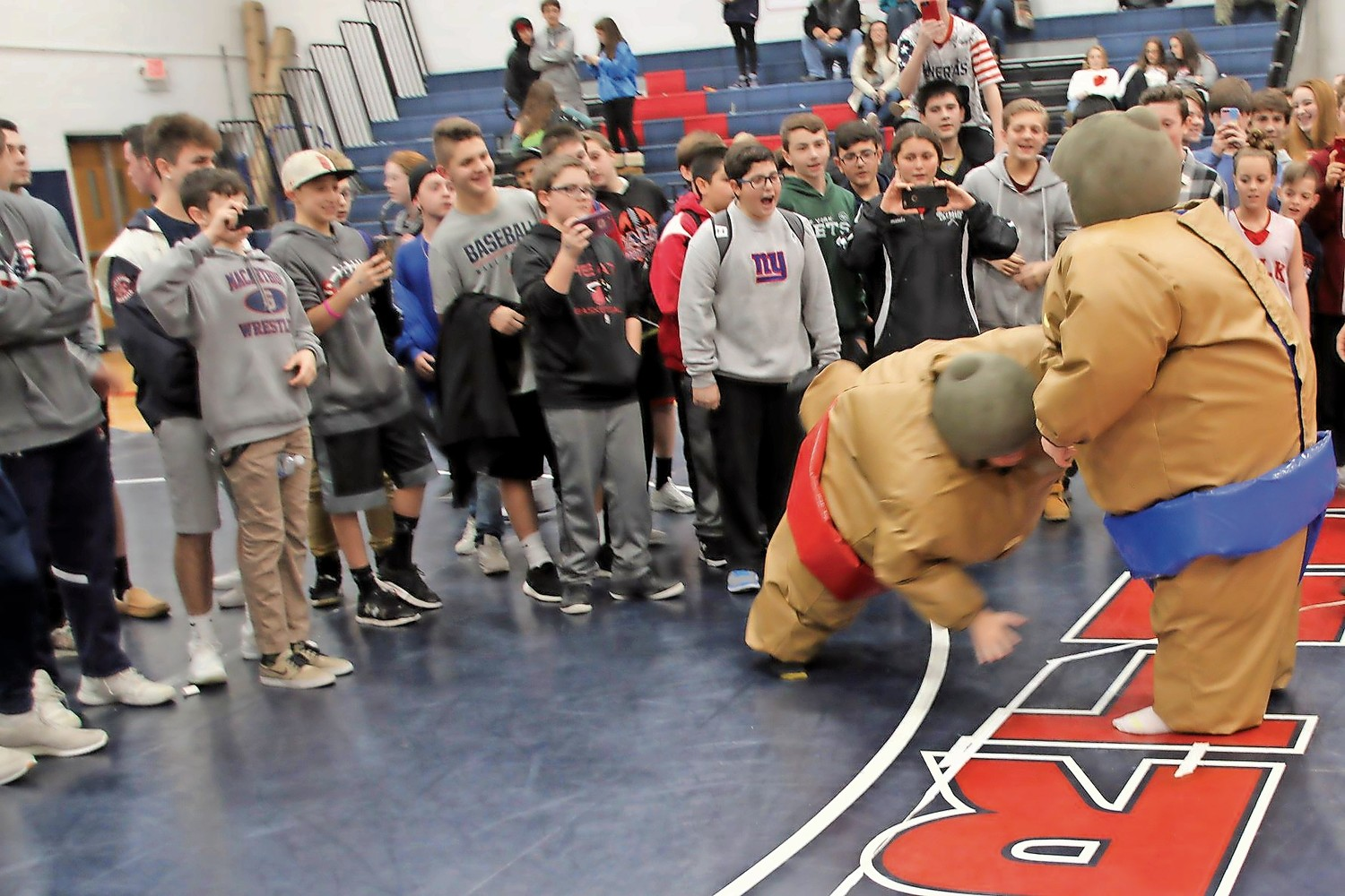 Students watched in amusement as sumo-wrestlers battled it out.