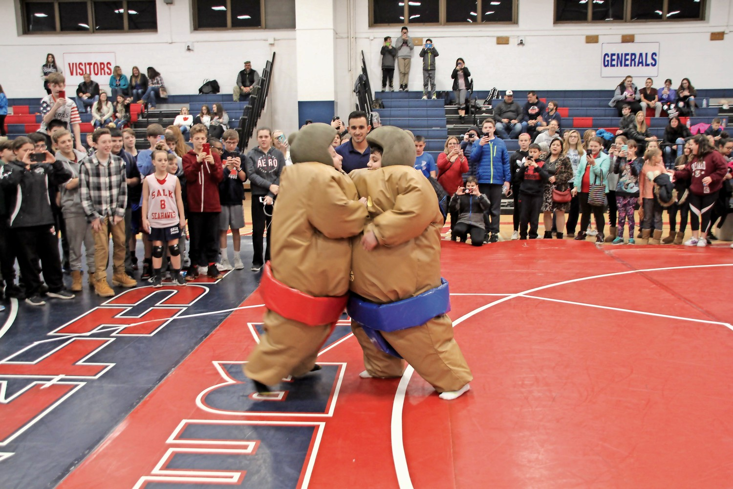 "Jonas E. Salk Middle School sumo wrestlers Jake ""The Snake"" Rothman, left, and Joe ""The Stallion"" Stallone duked it out at the sumo-wrestling event."