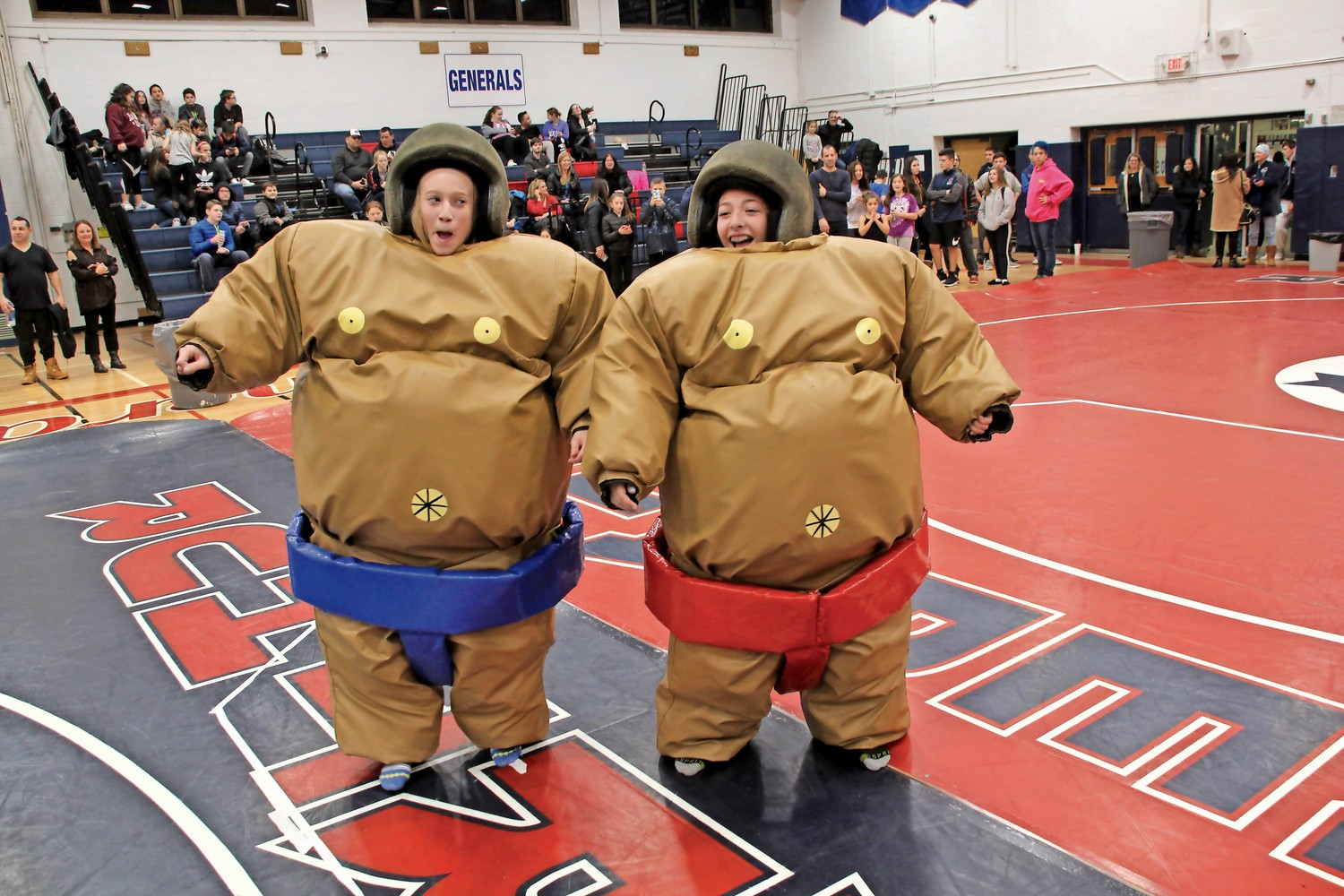 MacArthur High School students Juliana Weltner, left, and Abby DellVecchio prepared to wrestle in rubber suits at the school's third annual sumo-wrestling competition on Jan. 11.