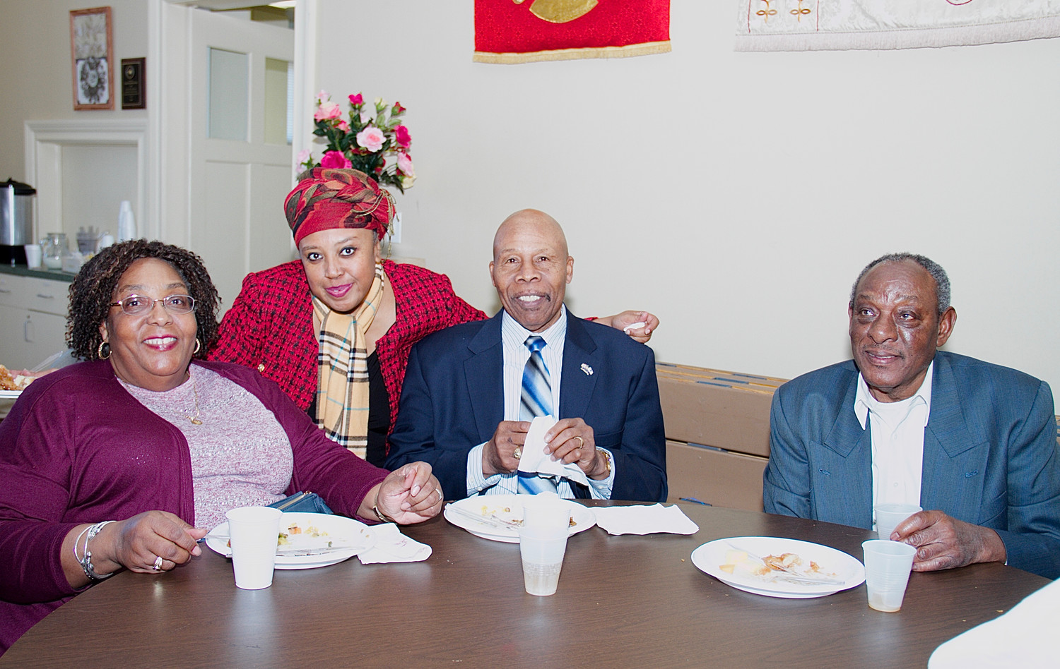 Viola Carter, far left, Denice Evans-Sheppard, Woody Vann,and Jay Green, from Hood AME, at the reception that followed the service.