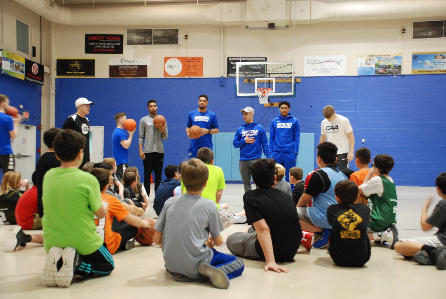 The Hofstra team introduced themselves to their young students, and spoke about the importance of hard work and practice.