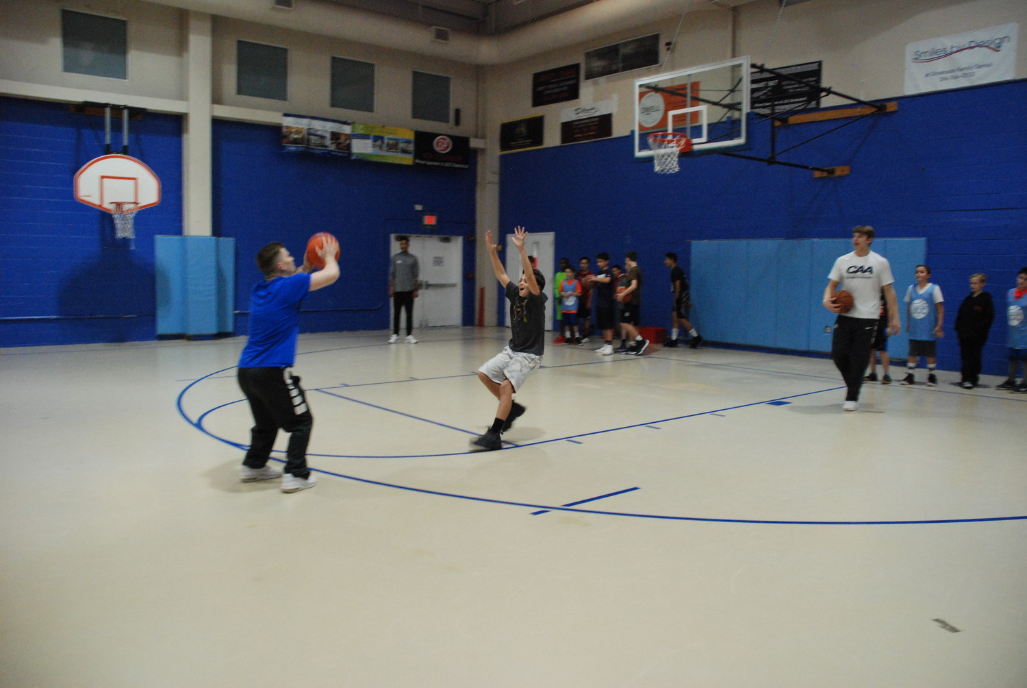 An older boy rushed a Hofstra Pride player for the lateral defensive drill.