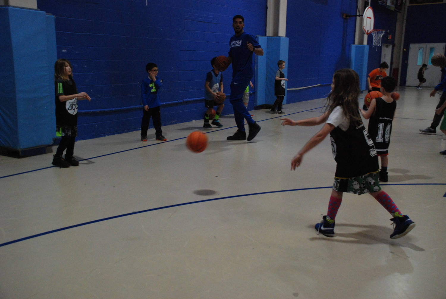 Two kids practiced as a Pride player gave tips for a good passing game.