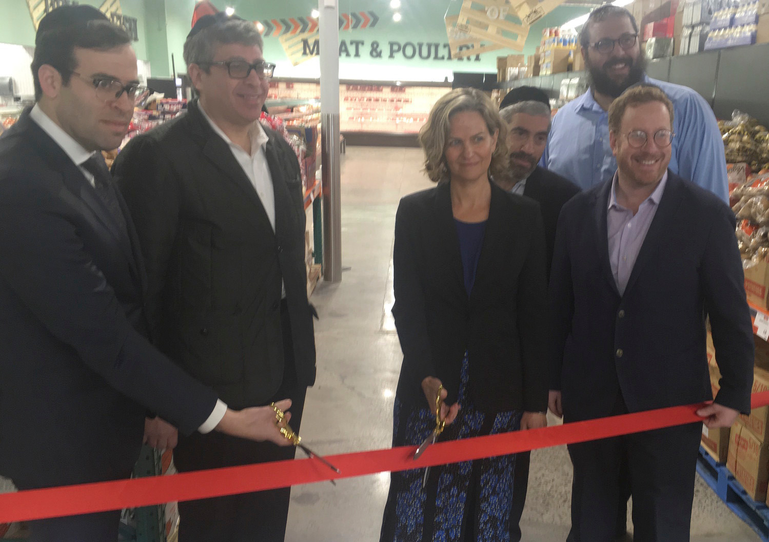 KolSave Market in Lawrence opened on Jan. 8. From left were Rabbi Boruch Bender, Yoeli Steinberg, Nassau County Executive Laura Curran, Howie Klagsburn, KolSave store manager Mendy Herz and Moshe Ratner.
