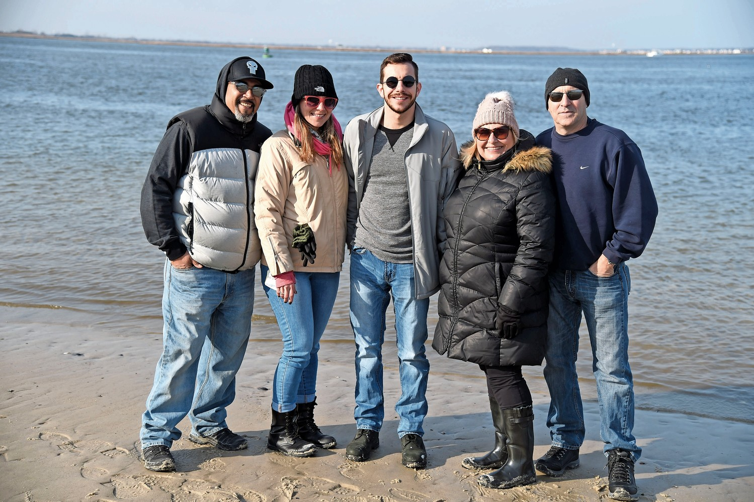Walking along the shoreline of Jones Beach's Field 10, looking for seals, were, from left, Chris Quiles, Justine Vendittelli, and Jack, Virginia and Kenny Hieb.