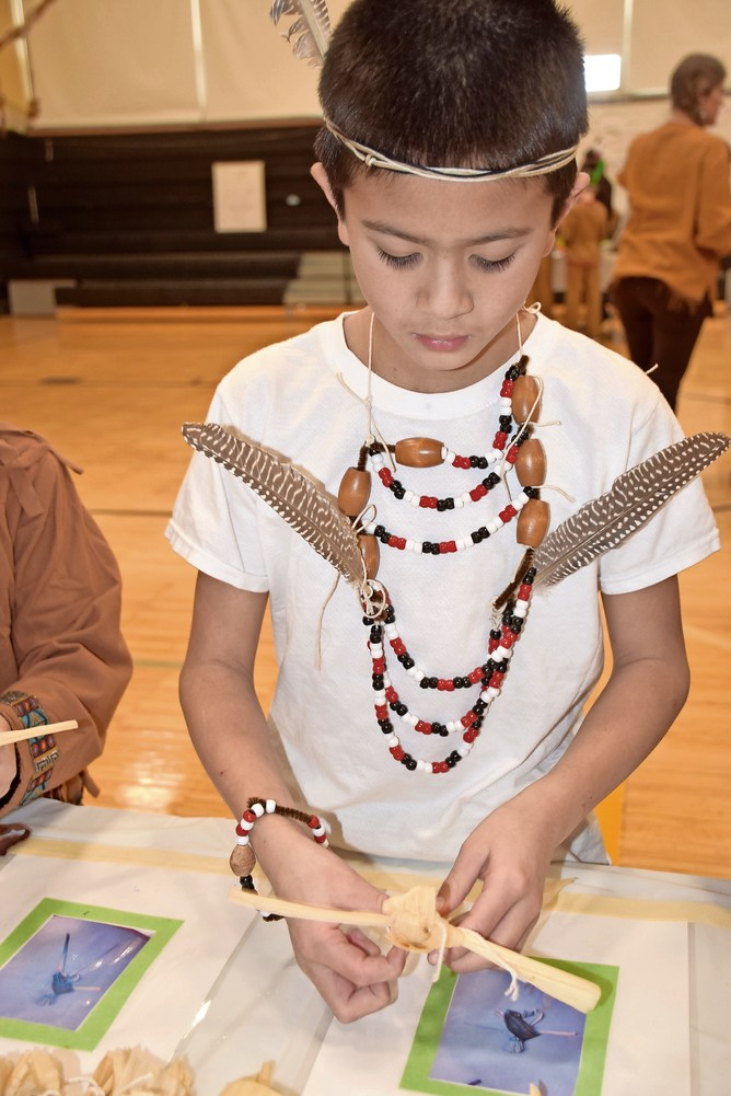 Zach Gruber, a fourth-grader at Forest Lake Elementary School in Wantagh, crafted a cornhusk doll to celebrate the school's Native American Day.
