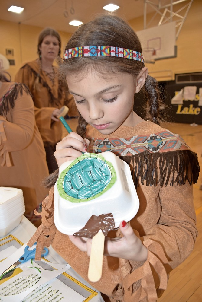 Reese McCarthy, a fourth-grader at Forest Lake Elementary School, put the finishing touches on a turtle rattle.