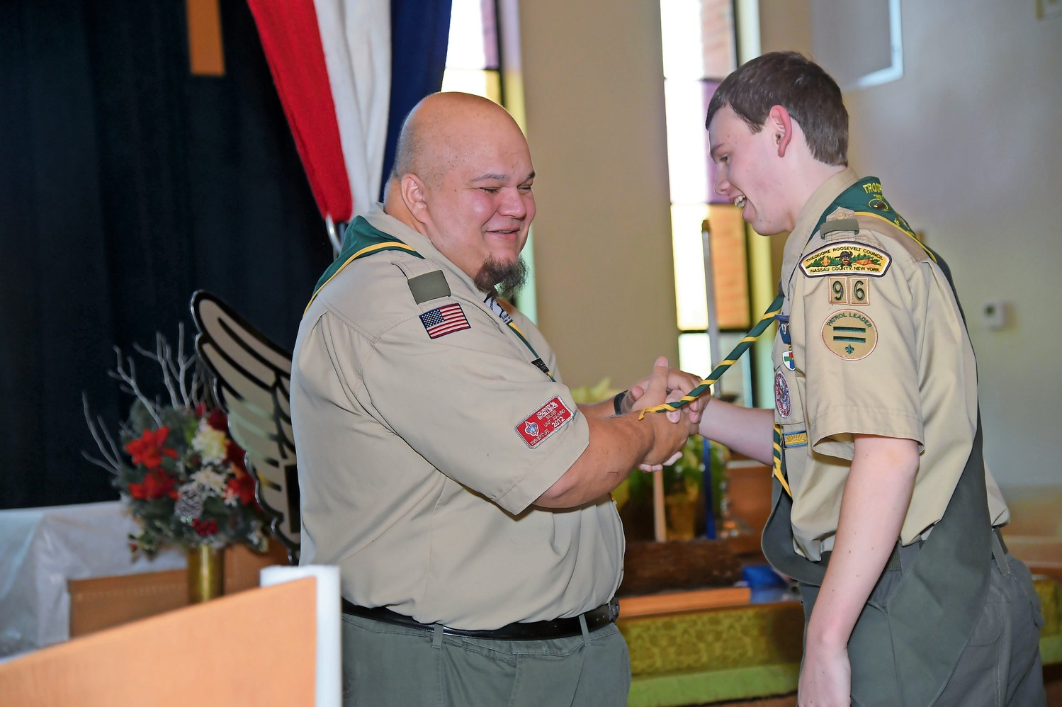 Parola thanked Troop 96 Assistant Scoutmaster Anthony Fillizola, left, after Fillizola spoke of Parola's journey to Eagle Scout.