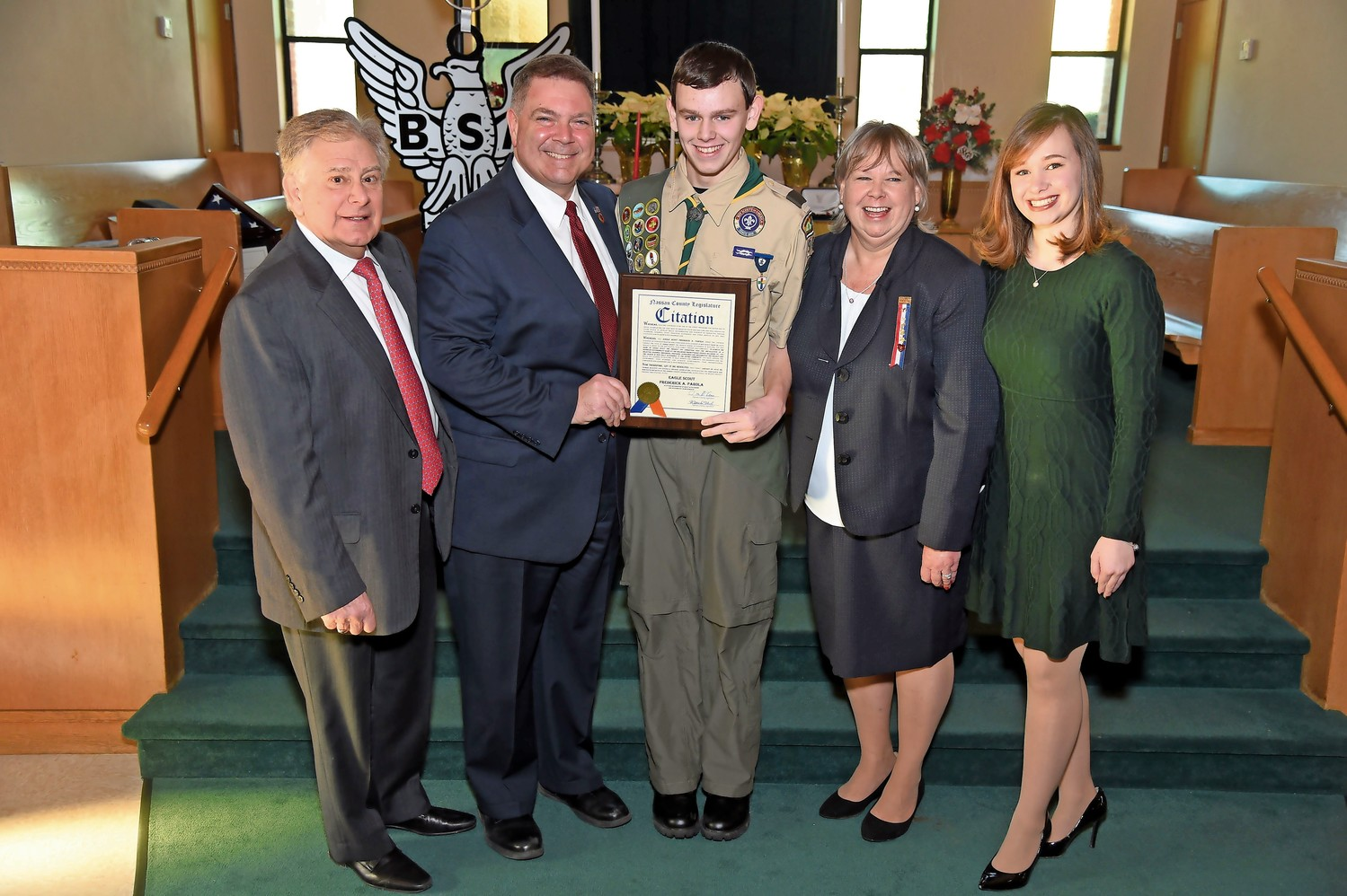New Eagle Scout Frederick A. Parola, center, who advanced to the rank at a Court of Honor ceremony on Jan. 20, posed with, from left, Fred Parola, Legislator Steve Rhoads, Norene Parola and Christine Parola.