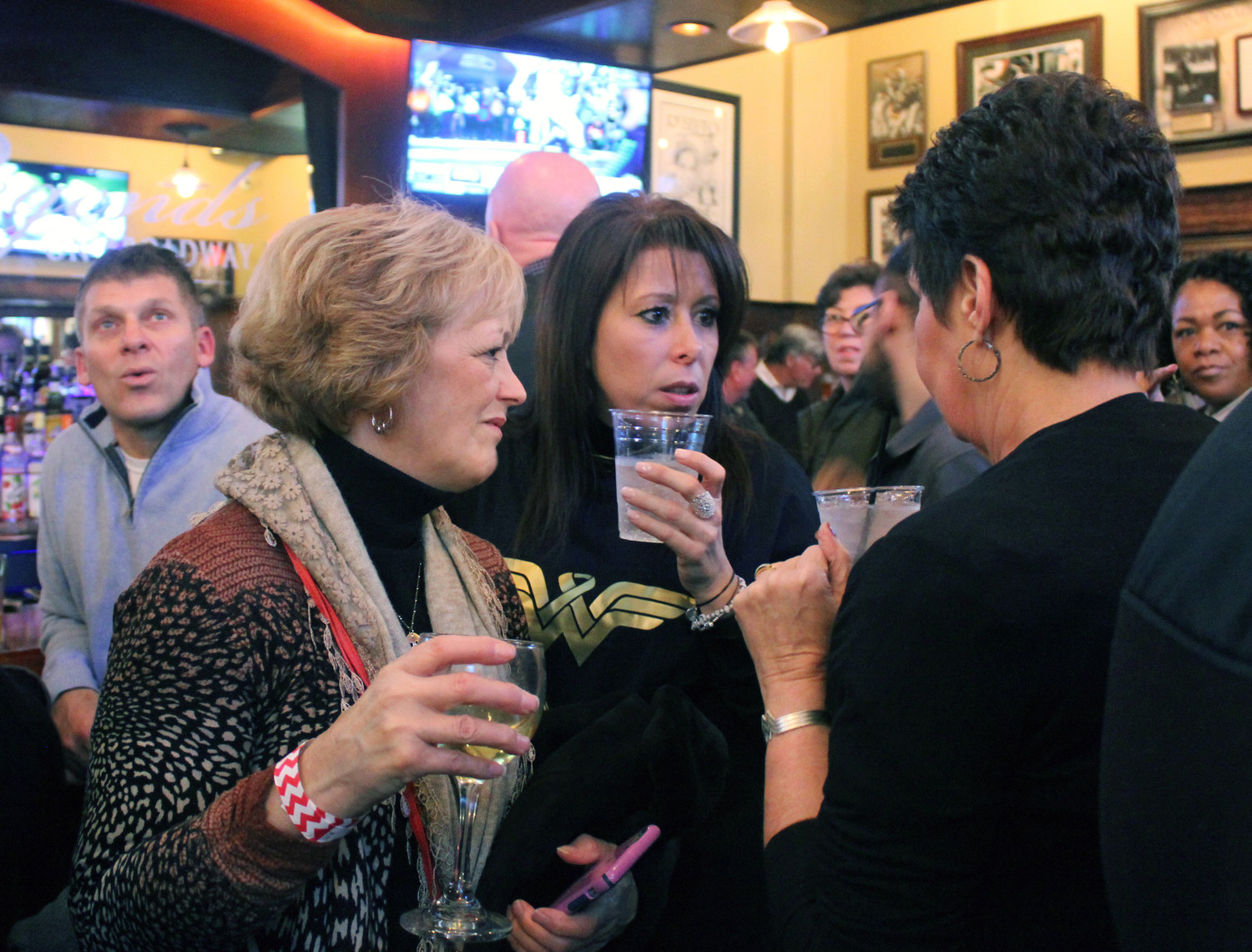 Diane Mucci, left, and Toni Valente are both co-workers with Millie Jones at the First National Bank of Long Island. They attended a Jan. 15 fundraiser for her at Legends of Broadway in Hicksville.