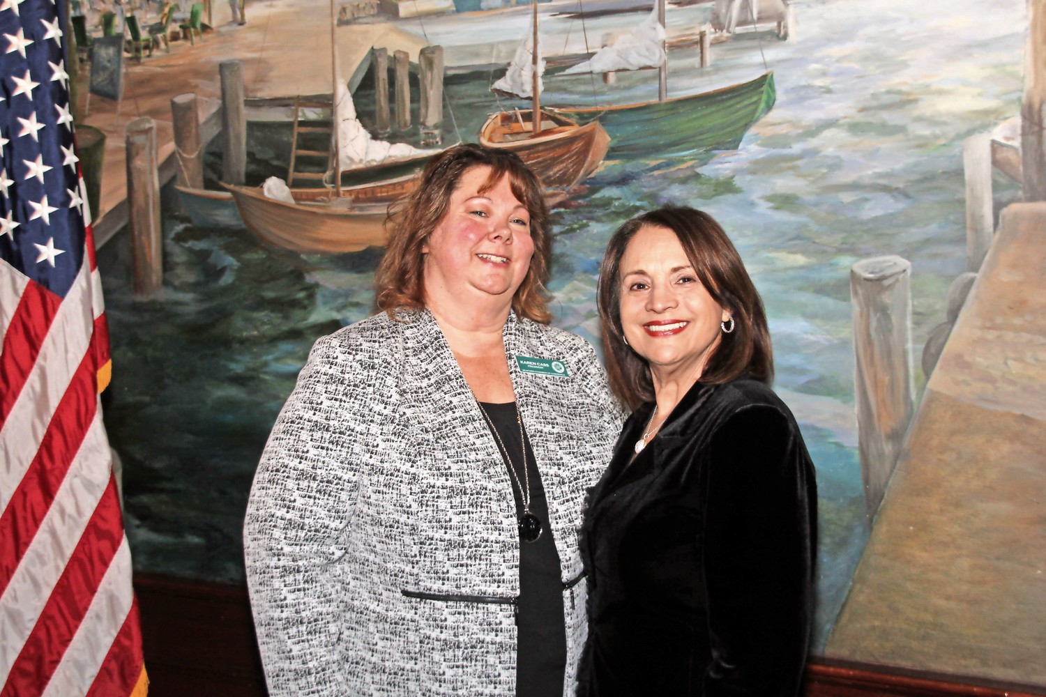 Juanita Duran, of Majestic Salon & Spa, congratulated Karen Cass, of EXIT Realty Premier, left, for being named president of the Seaford Chamber of Commerce.