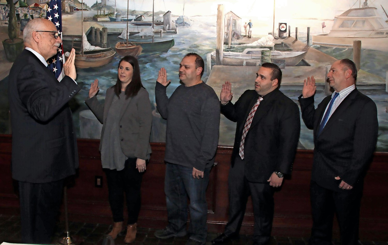 Hempstead Town Councilman Dennis Dunne Sr. swore in the new officers at the Seaford Chamber of Commerce installation ceremony. From left, Brigette DaSilva, secretary, Nick Bilotta, second vice president, Joe Calise, treasurer and Kenneth Jacobsen, first vice president.