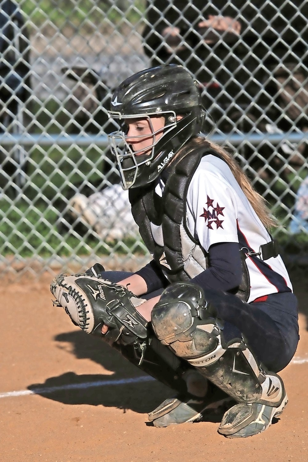Ashley Budrewicz, Jessica's twin and battery-mate, behind the plate.