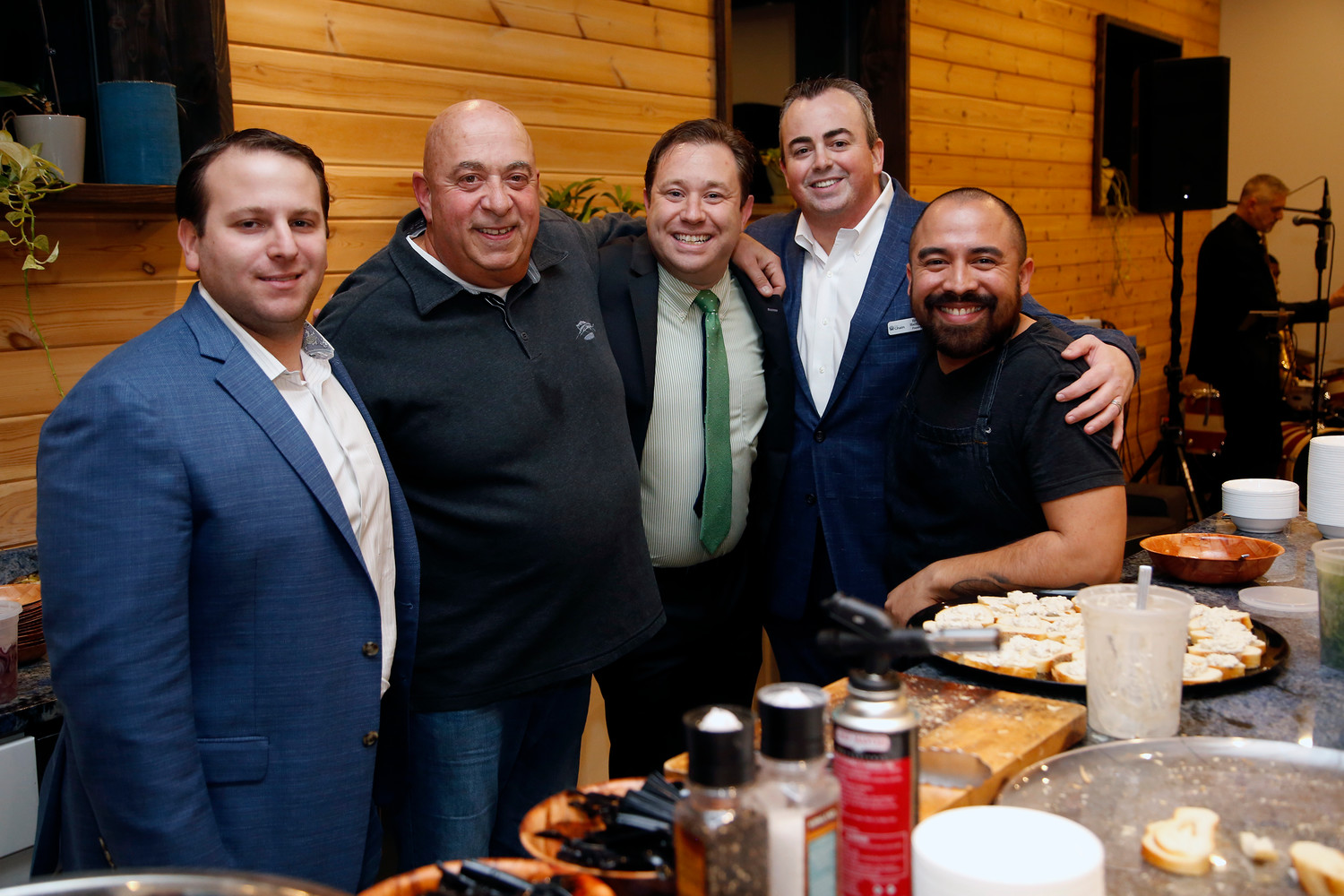 The Chain co-founder Garrett Guttenberg, left, Rob Blau, president of the Long Beach Soup Kitchen, Oceanside resident and organizer Andrew Berman, The Chain co-founder Brian Hallinan and Chef Ronnie Jaramillo at a Jan. 11 fundraiser benefitting the Long Beach Soup Kitchen.